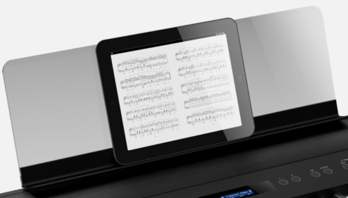 The transparent music rest that comes with the Roland FP-90.